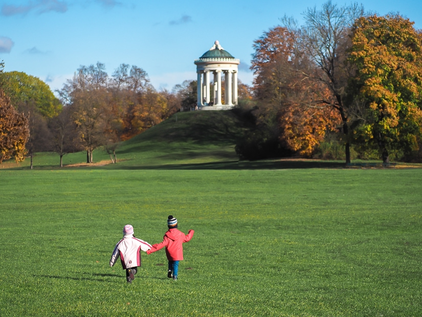 Our kids running across a field in Englischer Garten (English Garden) in Munich, Bavaria