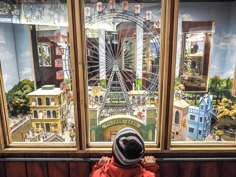My son looking at a artistic miniature version of the original Prater amusement park