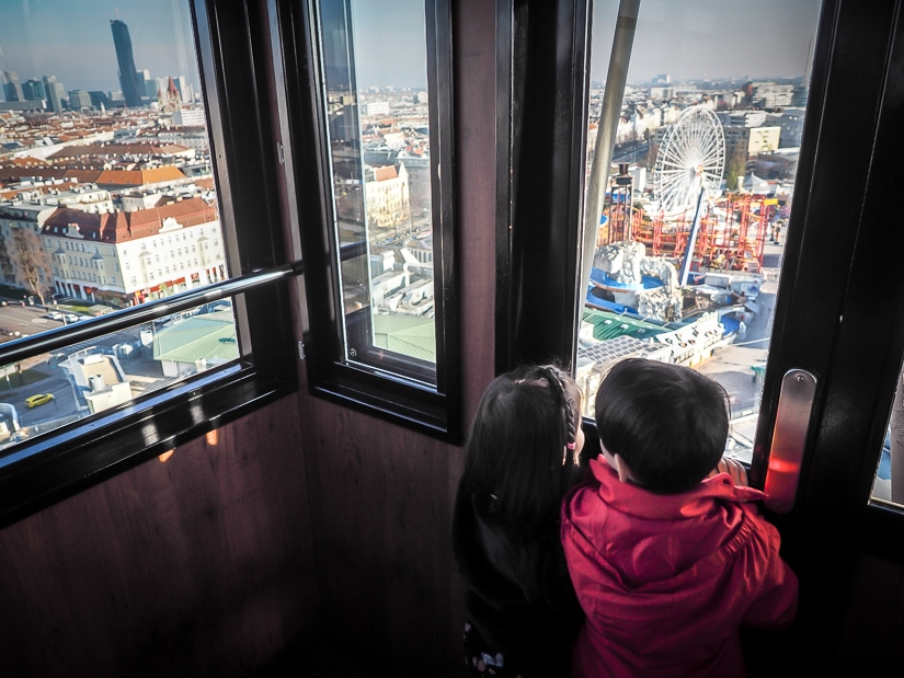 Our kids looking out from the Vienna Ferris wheel (Wiener Riesenrad), one of the best things to do with kids in Vienna