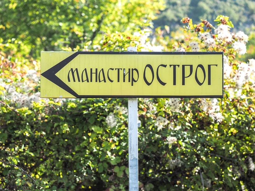 Sign point this way to Ostrog Monastery