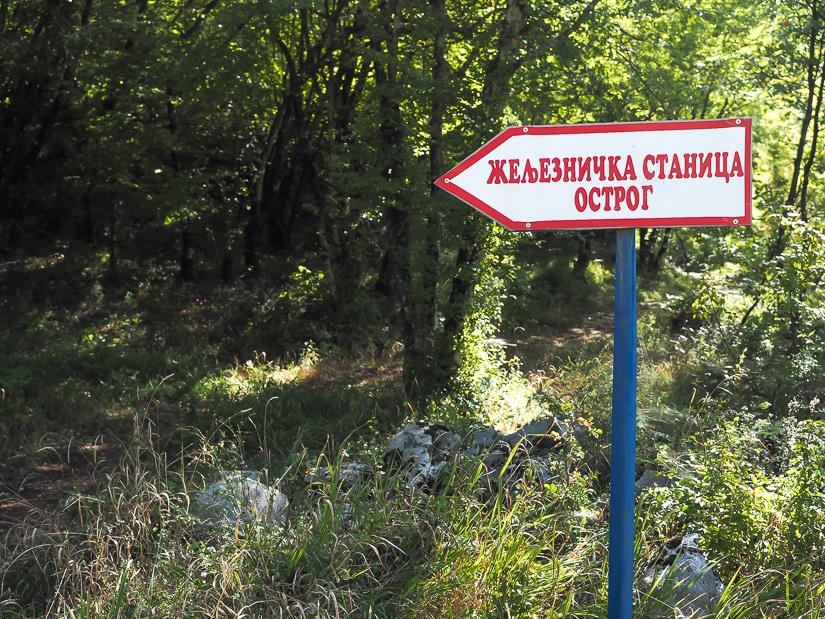 Sign pointing the way from Ostrog Monastery to Ostrog Railway Station