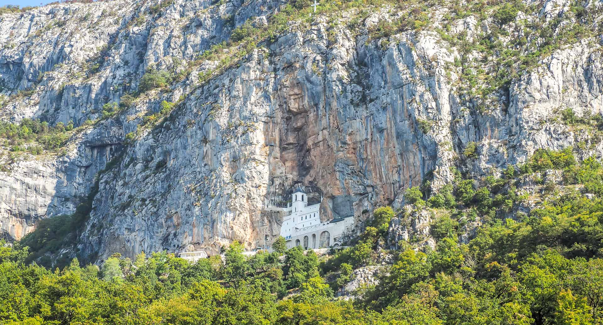 If you're looking to take an Ostrog Monastery tour or travel from Podgorica to Ostrog Monastery or Kotor to Ostrog Monastery, this article has all the details!