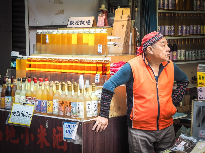 Aboriginal millet wine vendor on Wulai Old Street, a popular one-day trip from Taipei