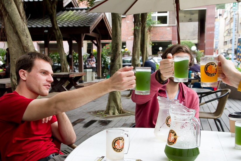 Our friends drinking green beer at Tangweigou hot spring park in Jiaoxi