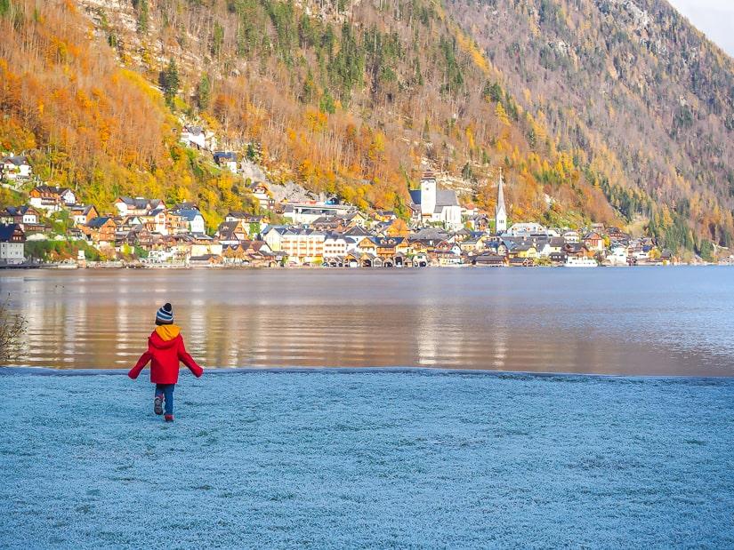 My son walking beside the lake in Hallstatt, a great family-friendly destination in Austria