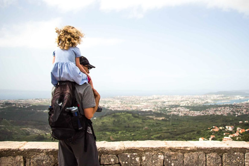 Looking down at the view from Klis fortress while visiting Split with children