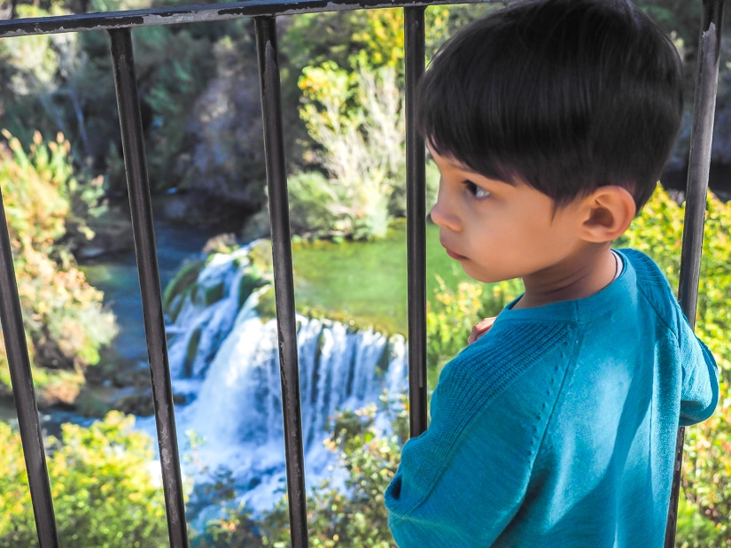 Overlooking a waterfall while visiting Krka National Park with children
