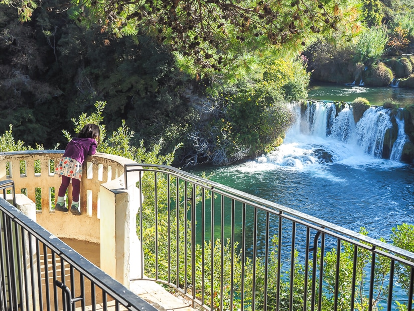 Visiting Krka with kids; here my daughter is overlooking one of the many waterfalls in the national park