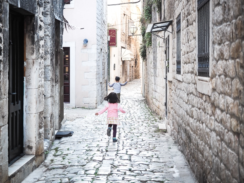 Our kids running through the narrow streets of Trogir, Croatia