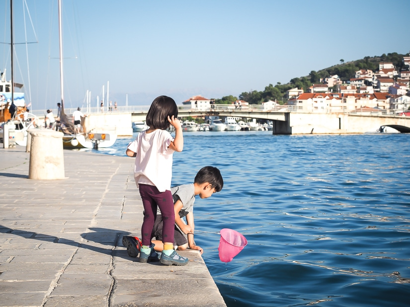 Visiting Trogir with kids, their favorite part was catching fish from the riva (promontory)
