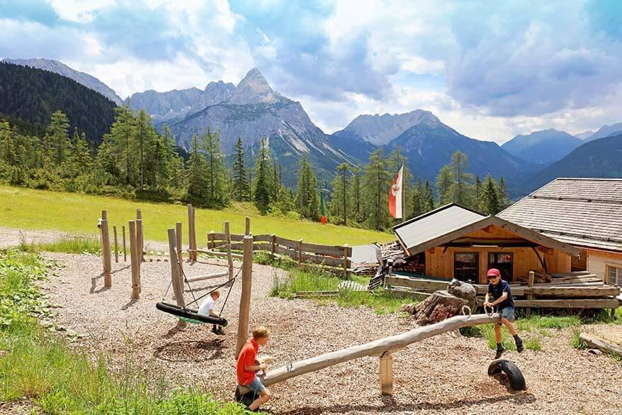 Kids on a seesaw in Tyrol, Austria
