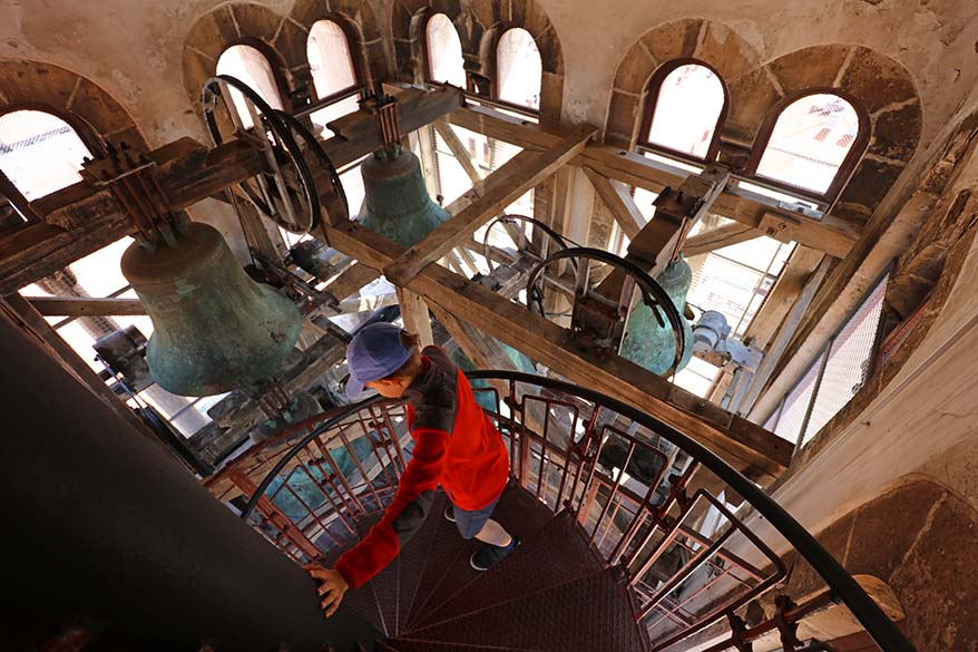 Children climbing inside the bell tower of Cathedral of St. Anastasia in Zadar, Croatia