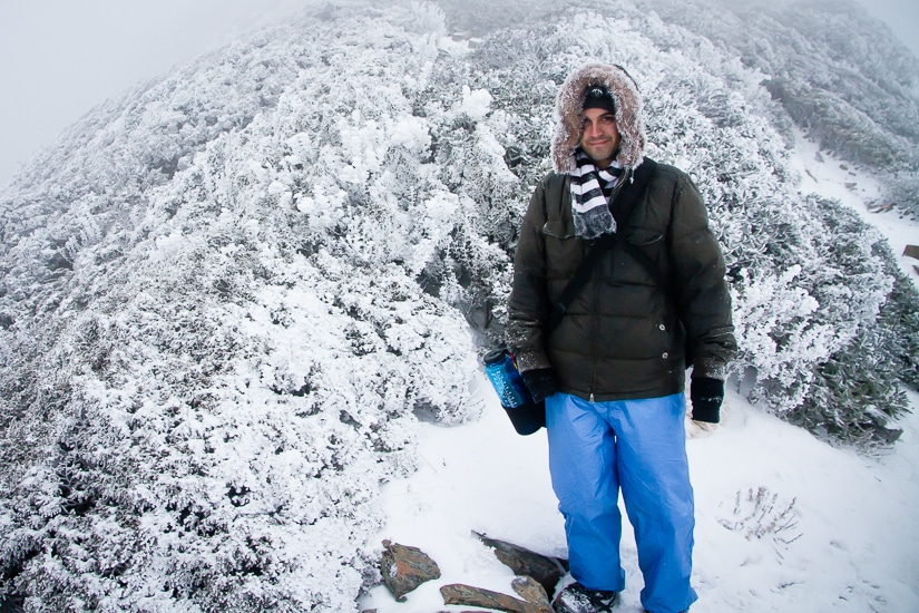 Me standing on the top of Snow Mountain in Taiwan with lots of snow around me