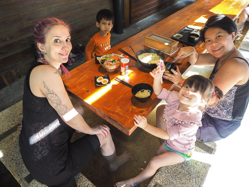 Soaking our feet while enjoying hot spring ramen, one of the best Jiaoxi restaurants