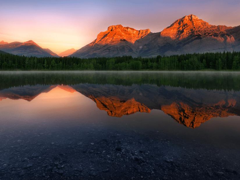 Sunrise over a lake in Kananaskis Country, Alberta