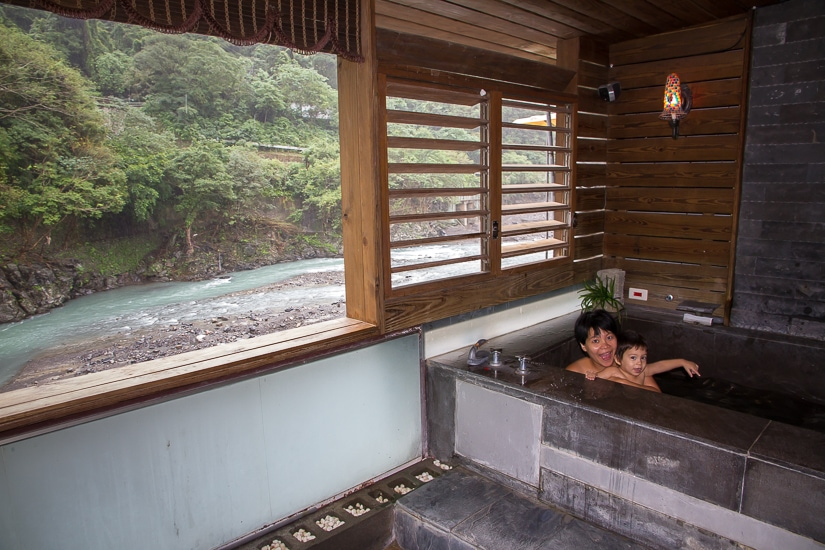 Mother and young son in a hot spring spa in Wulai