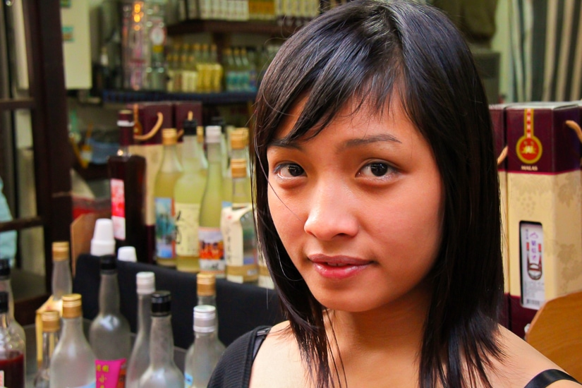 A young aboriginal woman at a millet wine store on Wulai Old Street