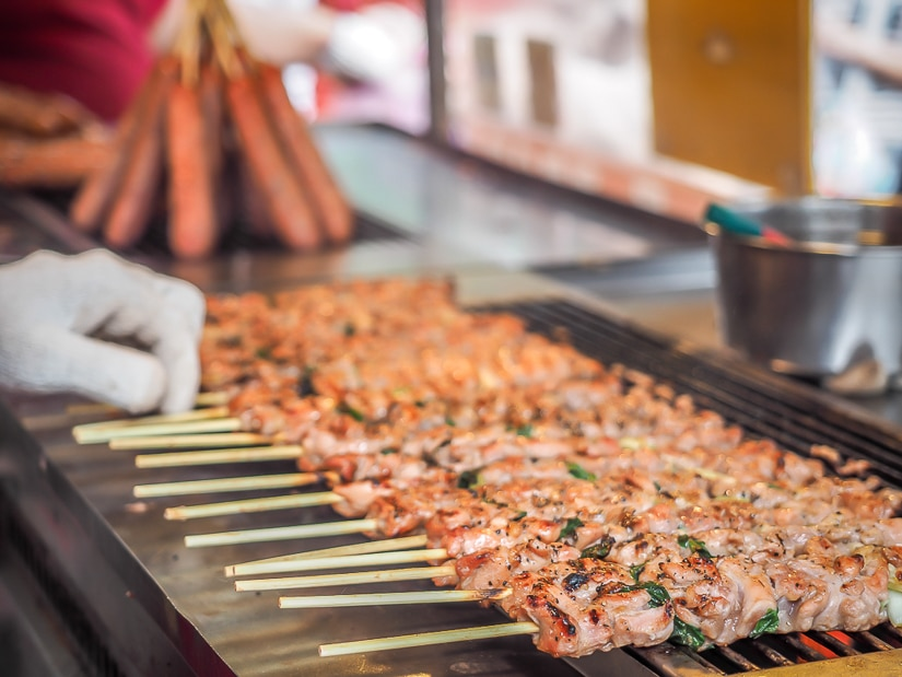 Aboriginal boar meat sticks being prepared by a vendor on Wulai Old Street