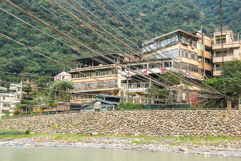 Nanshi River in Wulai, with a whole bunch of pipes in the air carrying Wulai hot spring water across the river to hot spring hotels in Wulai