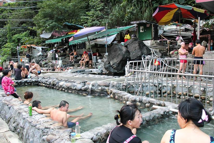 Stone hot spring pools at Wulai riverside thermal hot spring