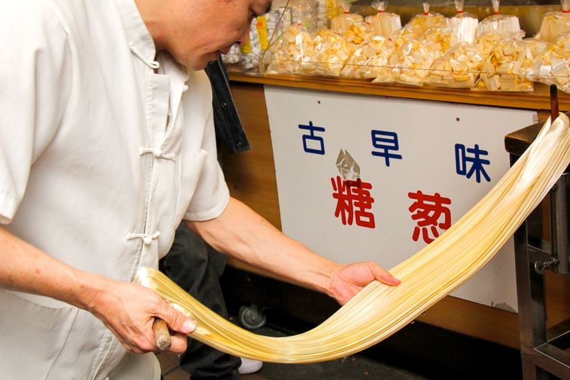 Traditional sugar candy being pulled on Wulai Old Street