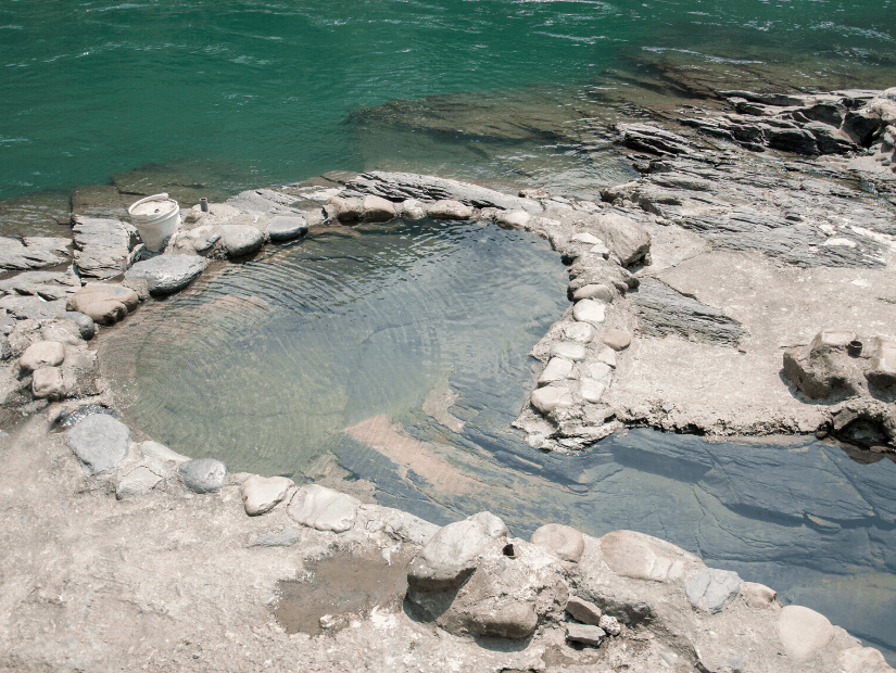 A natural hot spring in Wulai at the side of the river