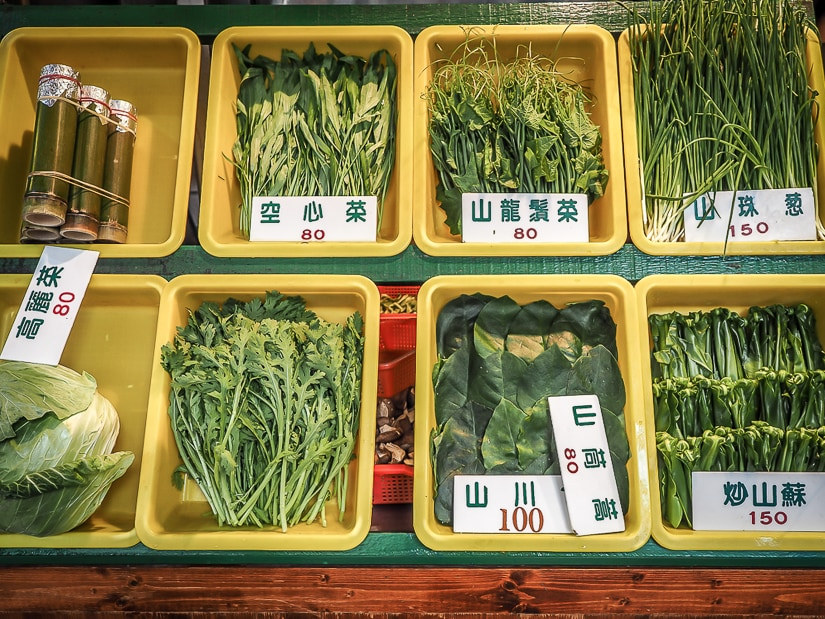Leafy mountain greens on display in front of one of the best restaurants in Wulai