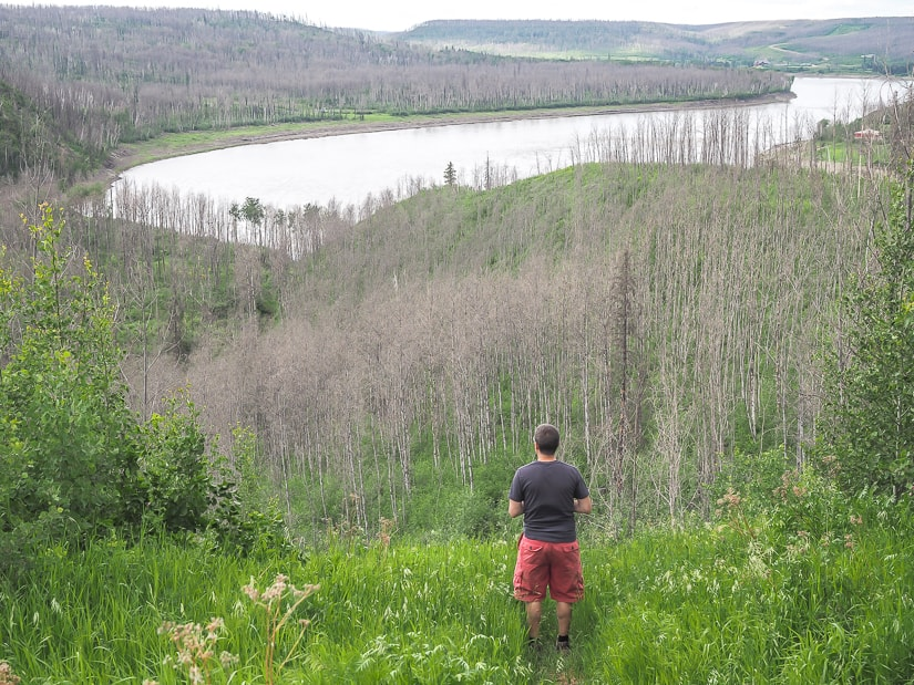 Man looking over Athabasca River Valley, Fort Mac