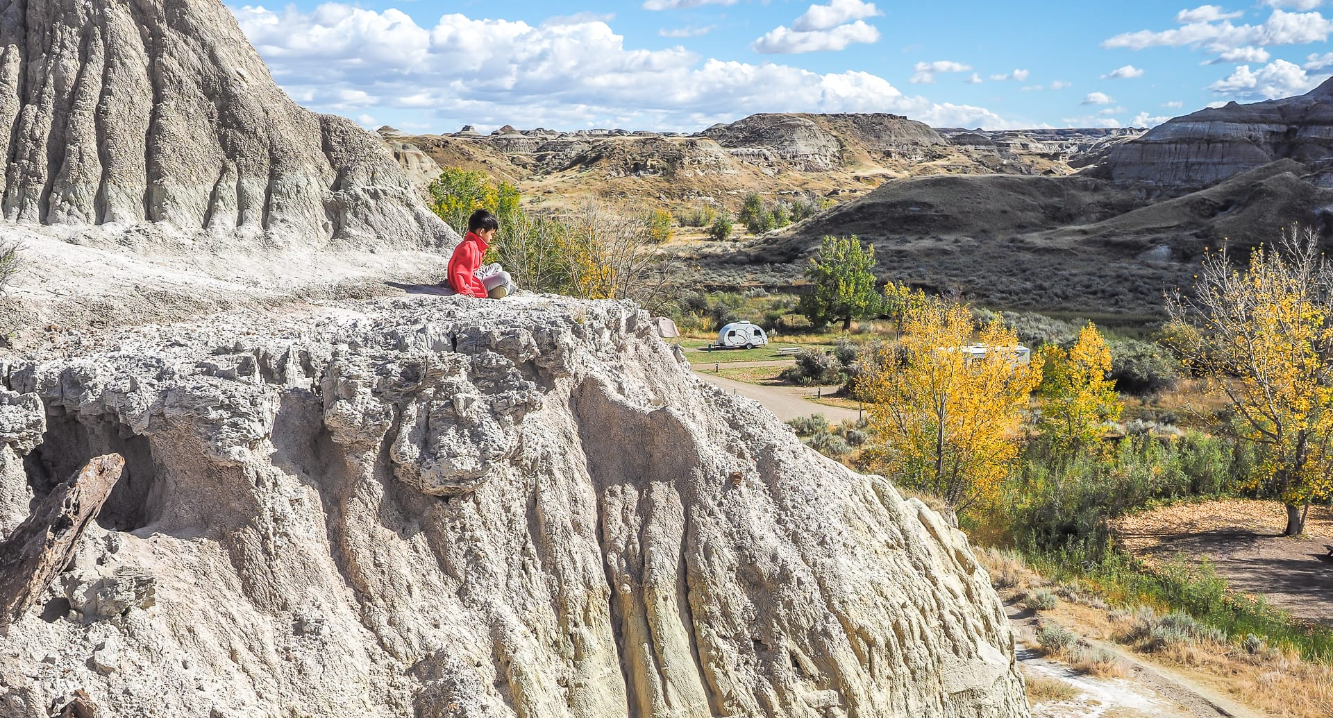 Boy looking over the Dinosaur Provincial Park Camping Site