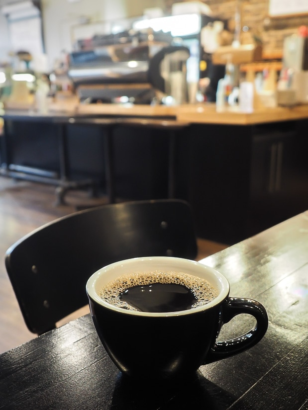 A cup of coffee on a table inside The Station, Medicine Hat