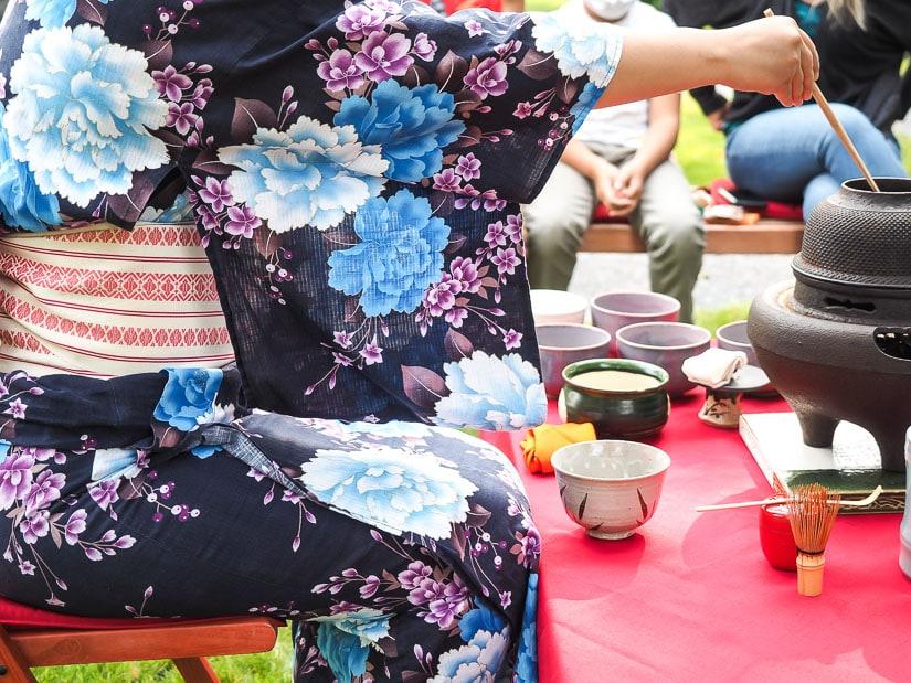 A woman performing Japanese tea ceremony at Nikka Yuko in Lethbridge