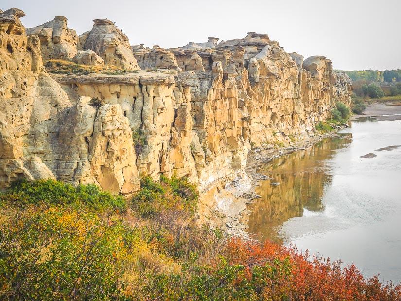 Cliffs and hoodoos beside Milk River in Writing-on-Stone Provincial Park, Alberta