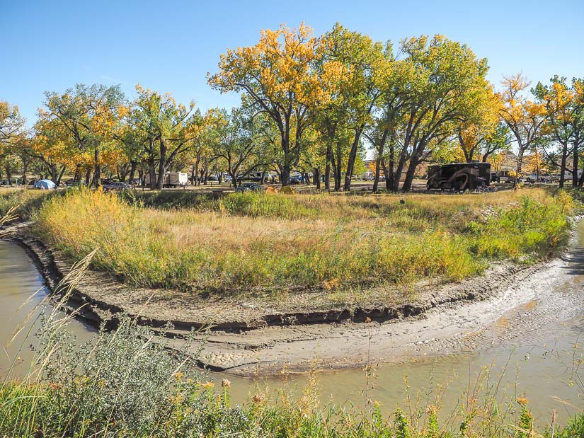 View across a creek to a section of the campground at Dinosaur Provincial Park