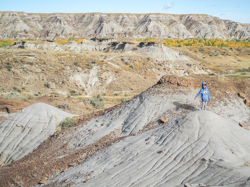 A boy on top of a hill in the badlands
