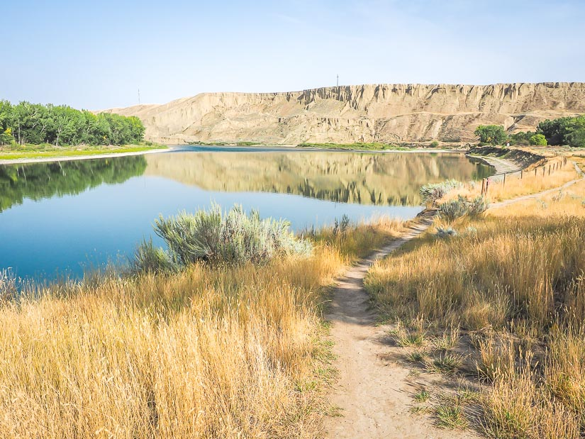 Walking path and beautiful view of South Saskatchewan River in Strathcona Island Park