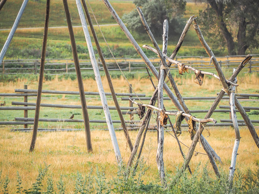 Teepee poles and drying animal furs at Fort Whoop-Up, one of the best family attractions in Lethbridge