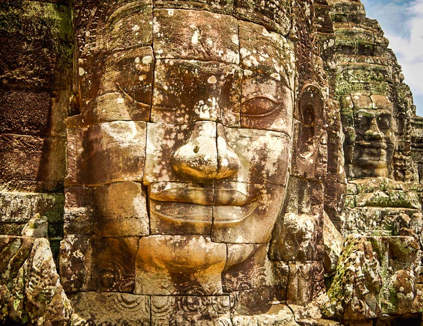 Giant Buddha faces of the Bayon in Angkor Wat, Cambodia, one of the greatest temple ruins in Southeast Asia and the world