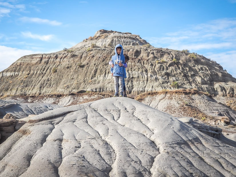 Kid standing on a hill in Dino Prov Park: the hikes there are very kid-friendly