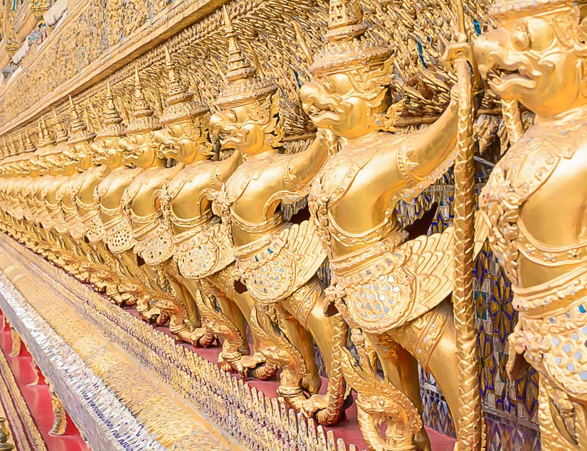 Golden statues on the exterior of Wat Phra Kaew, the most important temple in Thailand
