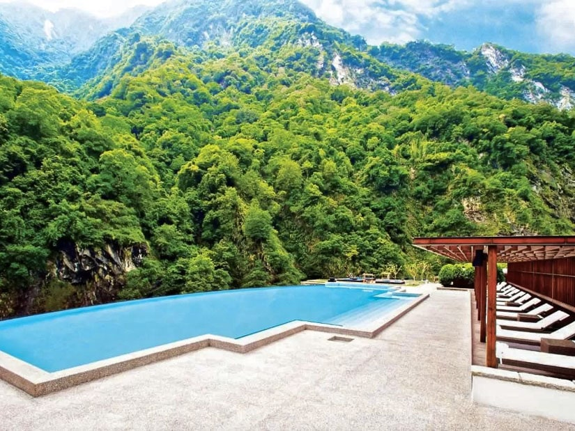 Pool backed by mountains at Silks Place, the best hotel in Hualien
