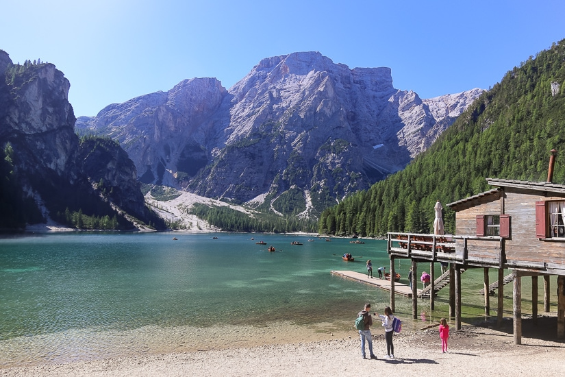 Some kids at a beautiful lake in the Dolomites of Italy