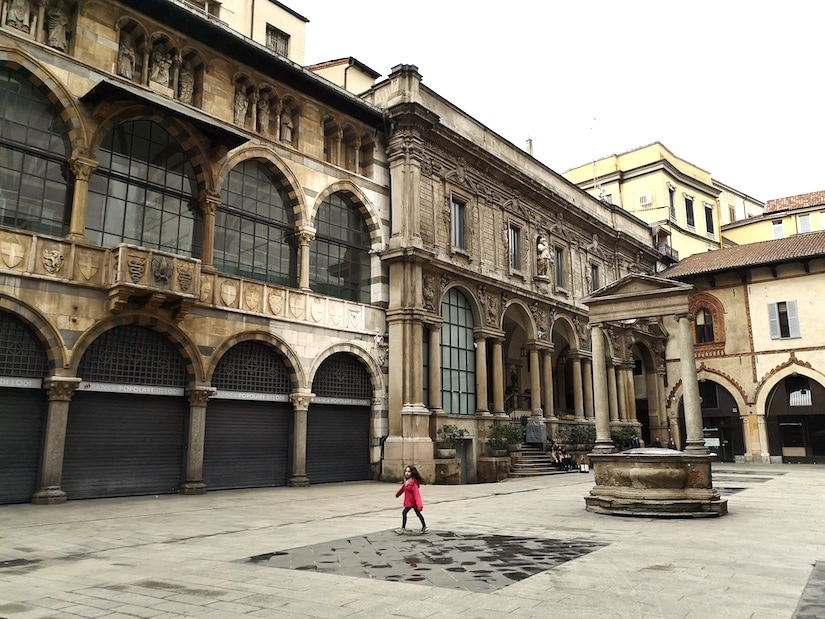 A child playing in a square in Milan
