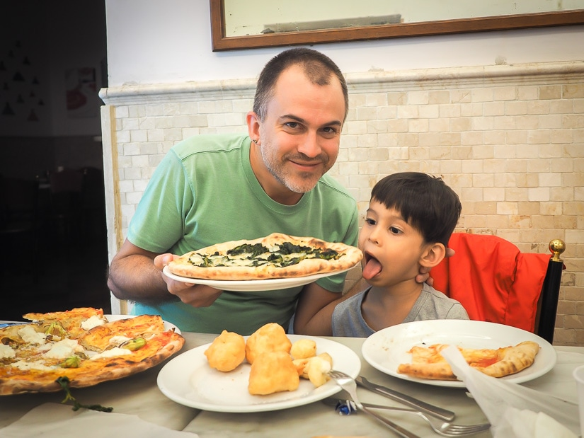 Eating pizza in Naples with kids
