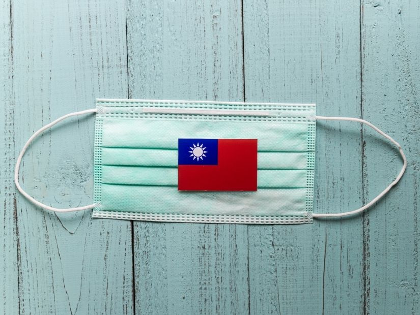 A mask with a Taiwan flag on it. One thing to be aware of if living in Taiwan is that mask wearing is very common there.