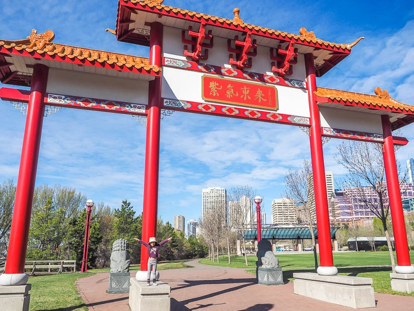 Girl standing on a Chinese Gate in Louise McKinney Park