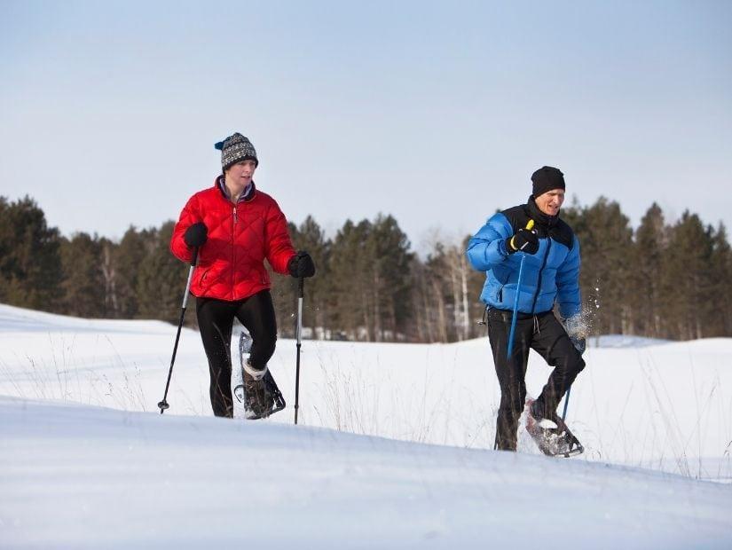 Two men snowshoeing