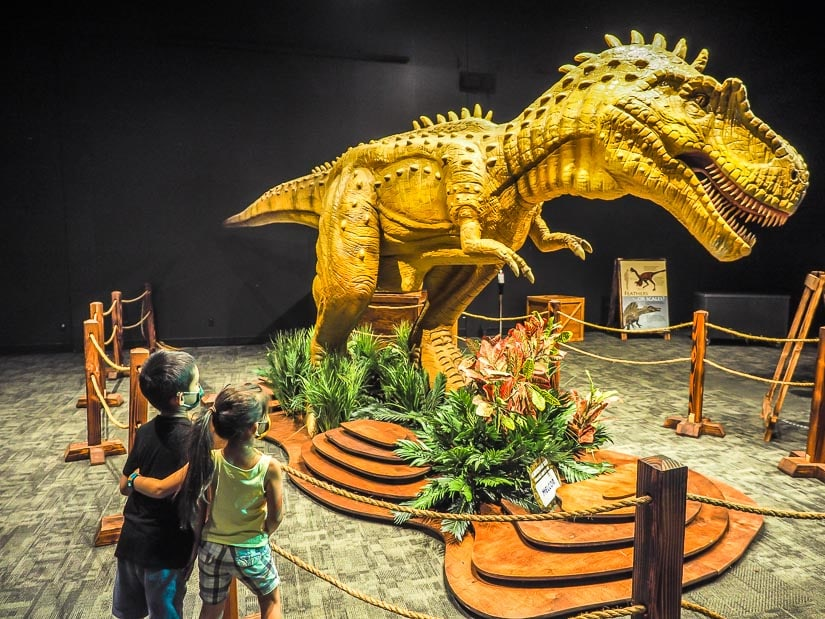 Two kids looking at a dinosaur in the Telus World of Science