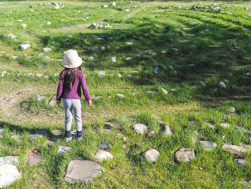 A girl walking in the Turtle Rock Effigy Layrinth