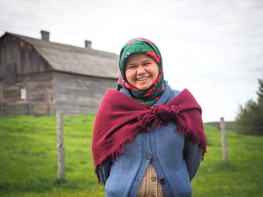 Interpreter standing in a field at Ukrainian Village