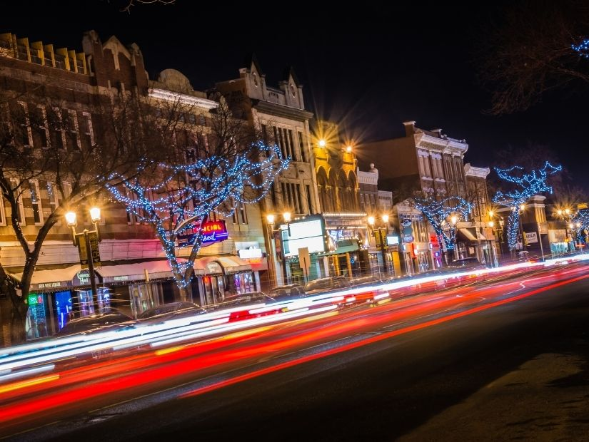Lights from cars zipping down Whyte Avenue at night
